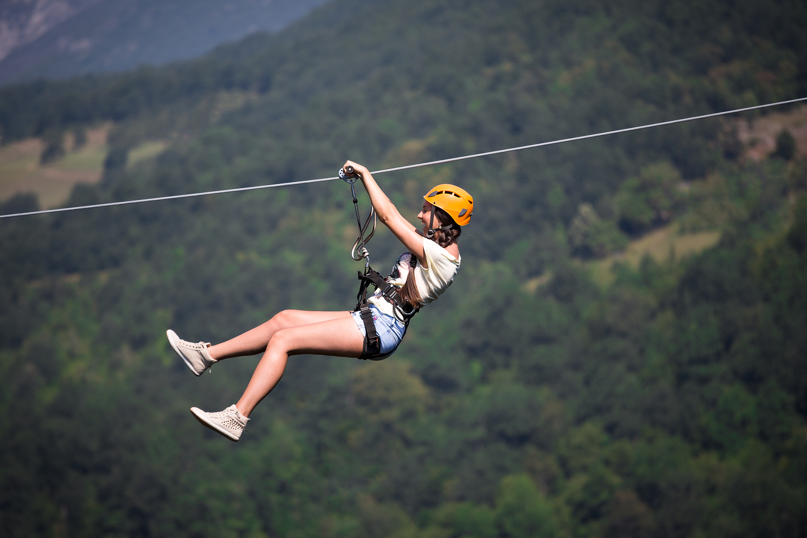 bigstock-Adult-woman-on-zip-line-89015582.jpg