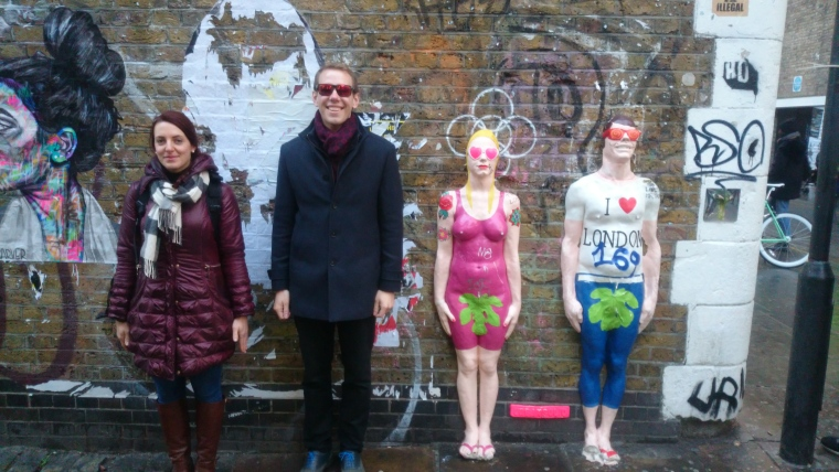 Two of our tour guests alongside some street art manakins!. We love you too, urbansolid!