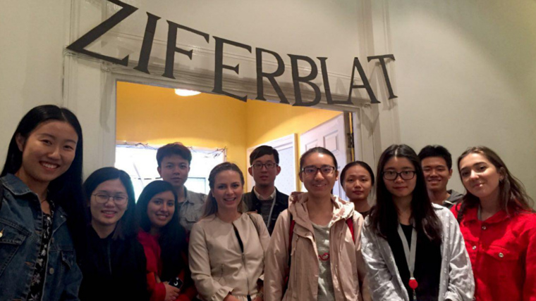 A group on students visiting Ziferblat - a great co-working/co-living-space we visit on the tour!
