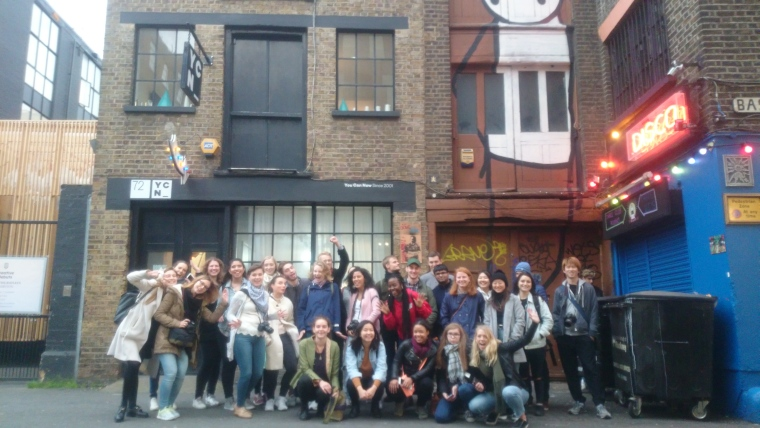 A large group of students in Rivington Street enjoying our london street art tour.