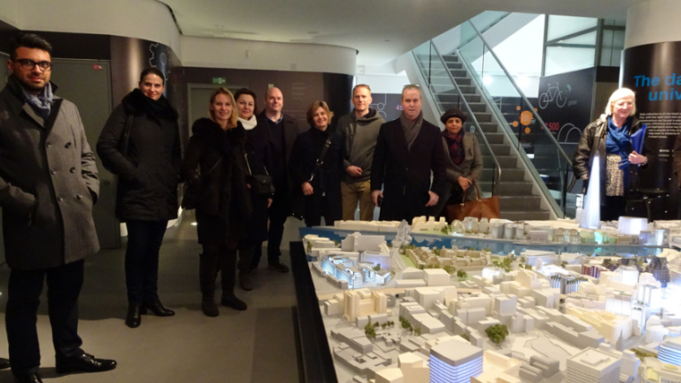 A group from Chapman Taylor, having a look at a model of the City on a bespoke tour.